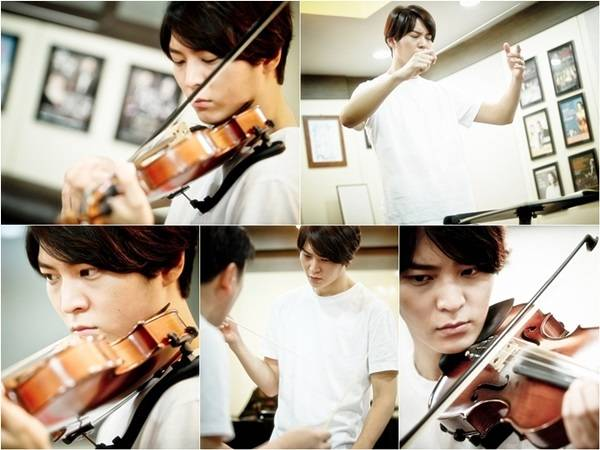 Joo Won Practices Conducting And Playing The Violin For