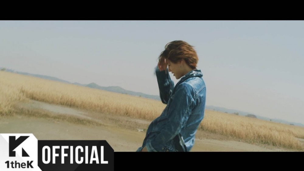 Image result for Woodz (UNIQ's Seungyoun) lays next to an ocean 'Pool' in MV!