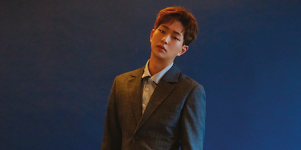 SHINee's Onew poses against 'B...