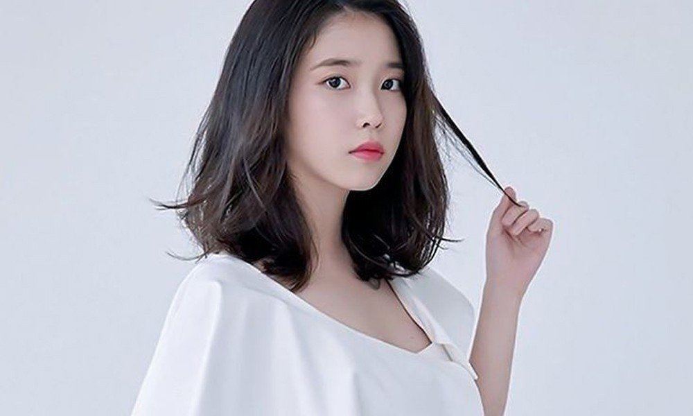 IU wraps up 2018 by donating 100 million won to ...